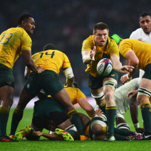 LONDON, ENGLAND - NOVEMBER 18:  Blake Enever of Australia offloads the ball during the Old Mutual Wealth Series match between England and Australia at Twickenham Stadium on November 18, 2017 in London, England.  (Photo by Dan Mullan/Getty Images)